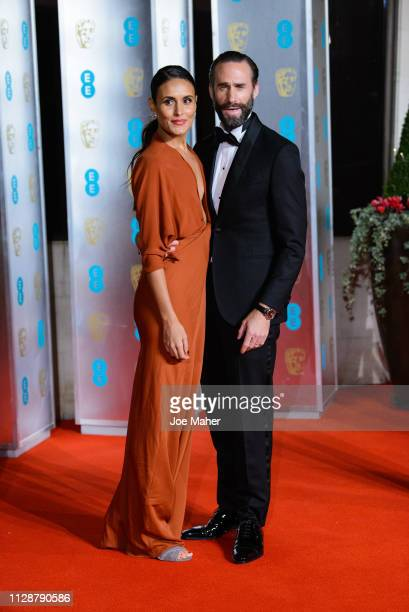 Maria Dolores Dieguez and Joseph Fiennes attend the EE British Academy Film Awards Gala Dinner at Grosvenor House on February 10 2019 in London...