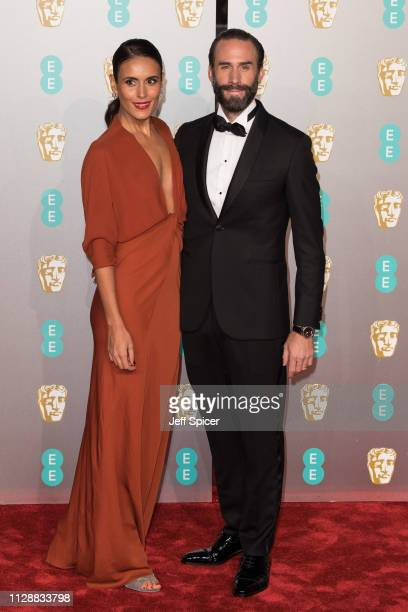 Maria Dolores Dieguez and Joseph Fiennes attend the EE British Academy Film Awards at Royal Albert Hall on February 10 2019 in London England