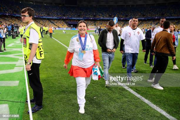 Maria Dolores dos Santos Aveiro, mother of Cristiano Ronaldo of Real Madrid, celebrates on the pitch after the UEFA Champions League final between...