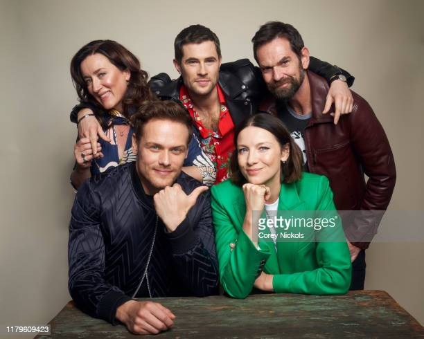 """Maria Doyle Kennedy, Sam Heughan, David Berry, Caitriona Balfe and Duncan Lacroix of """"Outlander"""" pose for a portrait during 2019 New York Comic Con..."""