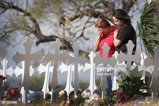 Maria Durand and her daughter Lupita Alcoces visit a memorial where 26 crosses stand in a field on the edge of town to honor the 26 victims killed at...
