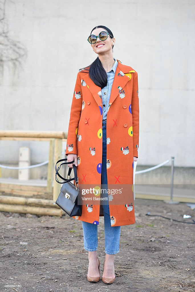 Maria Efrosinina poses wearing a Poustovit coat on Day 6 of Paris Fashion Week Womenswear FW15 on March 8, 2015 in Paris, France.