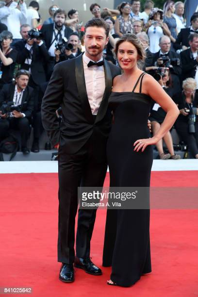 Maria Elena Boschi and her brother Emmanuel Boschi walk the red carpet ahead of the 'Downsizing' screening and Opening Ceremony during the 74th...