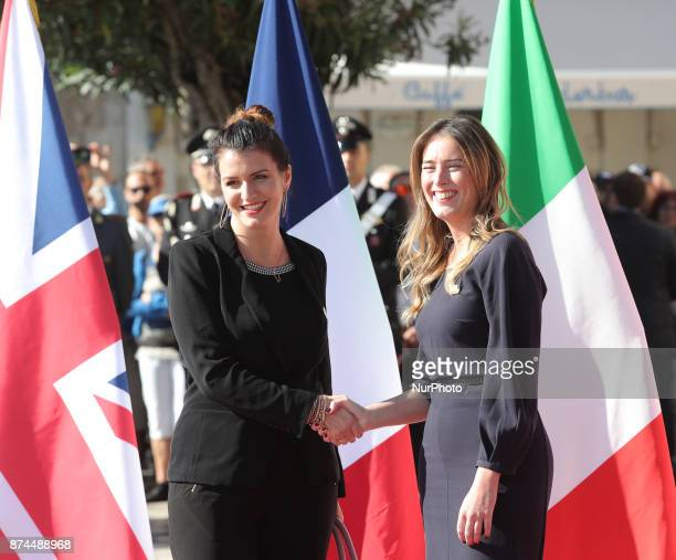 Maria Elena Boschi of Italy shakes hands to Marlene Schiappa of France during G7 Ministerial Meeting on Gender Equality held in Taormina Italy on...