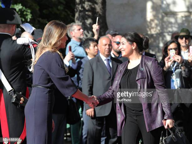 Maria Elena Boschi of Italy shakes hands to Maryam Monsef of Canada during G7 Ministerial Meeting on Gender Equality held in Taormina Italy on 1516...