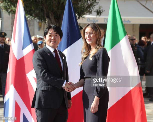 Maria Elena Boschi of Italy shakes hands to Yuhei Yamashita of Japan during G7 Ministerial Meeting on Gender Equality held in Taormina Italy on 1516...