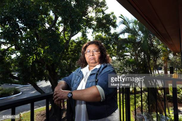Maria Elena Hernandez a 57yearold immigrant from Nicaragua stands on the balcony of an apartment in Plantation that she shares with her family...