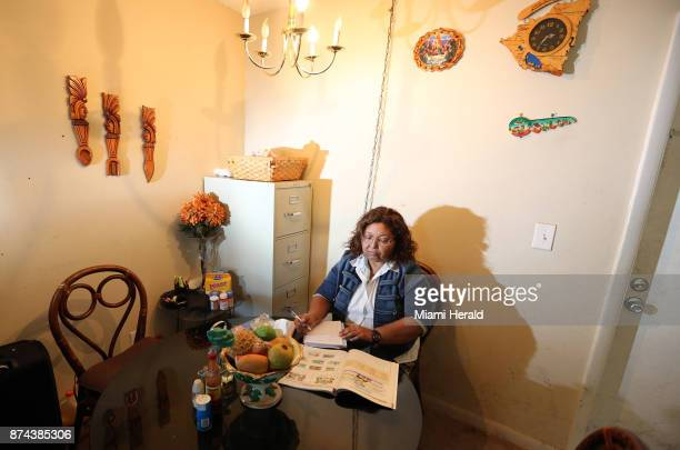 Maria Elena Hernandez a 57yearold immigrant from Nicaragua works on English homework for a class she is taking at the dining room table of an...