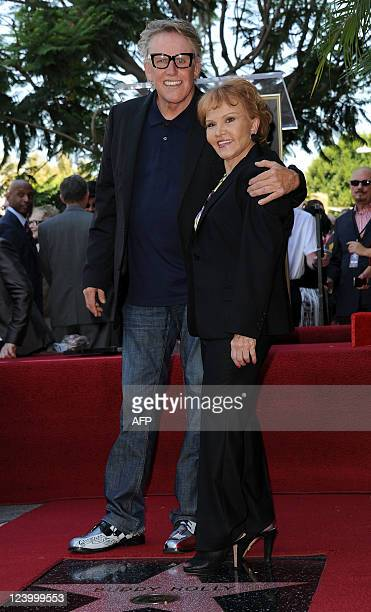 Maria Elena Holly and Gary Busey attend the Buddy Holly Hollywood Walk Of Fame Induction Ceremony in Hollywood California September 7 2011 AFP...
