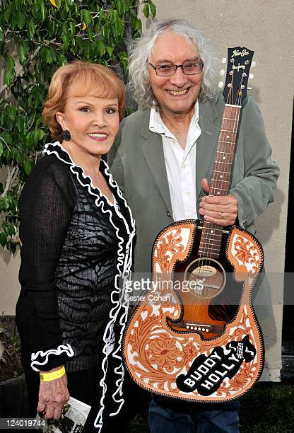 Maria Elena Holly and musician Albert Lee attends a concert in celebration of Buddy Holly's music and legacy held at The Music Box Theatre on...