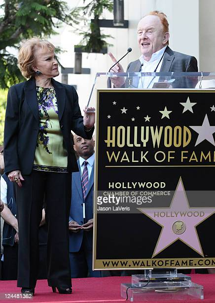 Maria Elena Holly and producer Peter Asher attend Buddy Holly's induction into The Hollywood Walk of Fame on September 7 2011 in Hollywood California