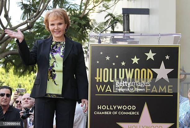 Maria Elena Holly poses for photographers during the ceremony for recording artist Buddy Holly's posthumous star on the Hollywood Walk of Fame on...