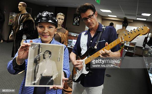 Maria Elena Holly who is the widow of rock legend Buddy Holly holds a rare studio photo of him beside Holly impersonator John Mueller before an...