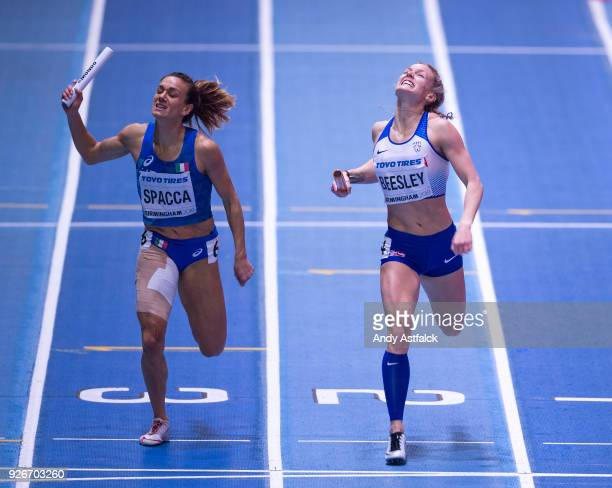 Maria Enrica Spacca from Italy and Meghan Beesley of Great Britain during Round 1 of the Womens 4x400m Relay on Day 3 of the IAAF World Indoor...