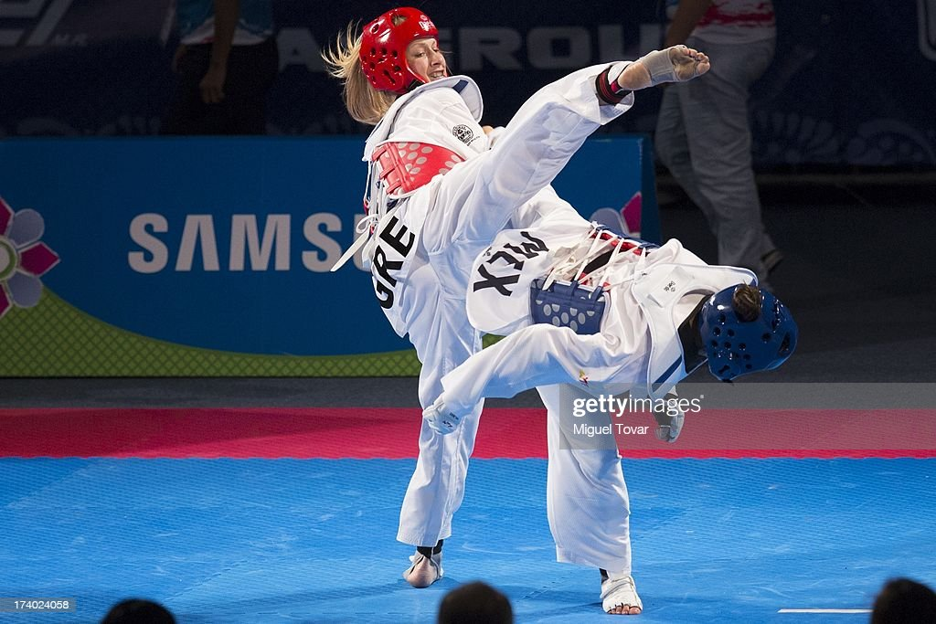 Maria Espinoza of Mexico (blue) competes with Marina Dimitropoulou of Grecia (red) during a women's -73 kg combat of WTF World Taekwondo Championships 2013 at the exhibitions Center on July 19, 2013 in Puebla, Mexico.