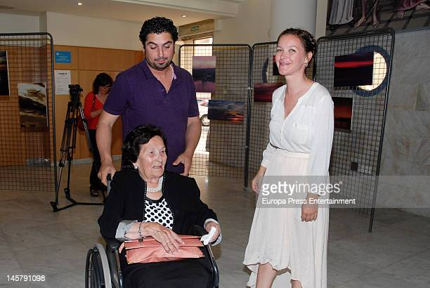Maria Esteve, her grandmother and her husband Antonio Garrido attend her picture exhibition 'De Malaga Al Cielo' on May 16, 2012 in Malaga, Spain.