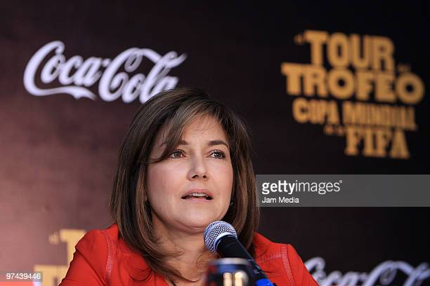Maria Eugenia del Rio, Director of Coca-Cola Mexico, speaks during the opening of the Fifa World Cup Trophy exhibition at Coca-Cola headquarters as...