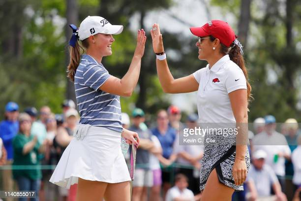 Maria Fassi of Mexico and Jennifer Kupcho of the United States react on the 18th green during the final round of the Augusta National Women's Amateur...