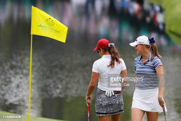 Maria Fassi of Mexico and Jennifer Kupcho of the United States react on the 16th green during the final round of the Augusta National Women's Amateur...