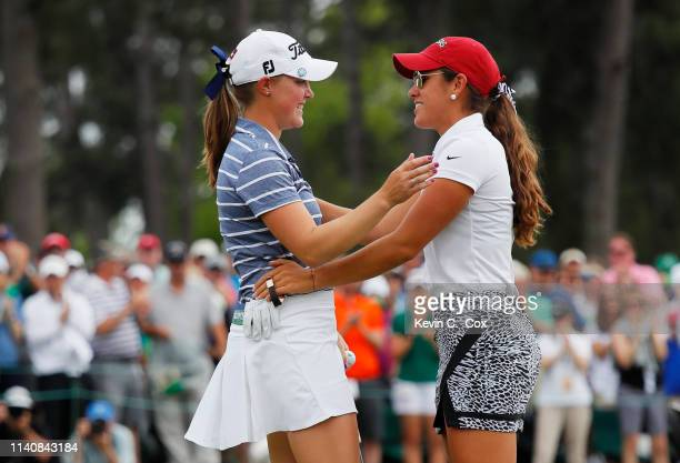 Maria Fassi of Mexico congratulates Jennifer Kupcho of the United States on the 18th green after Kupcho won during the final round of the Augusta...