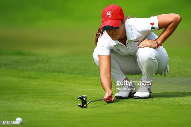 Maria Fassi of Mexico eyes up a putt during the final round of the Lorena Ochoa Invitational 2016 at Club de Golf on November 13 2016 in Mexico City...