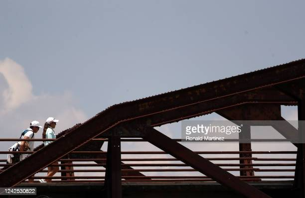 Maria Fassi of Mexico walks across a bridge to the 2nd tee during the first round of the Energy Producers Inc Texas Women's Open on June 02 2020 in...