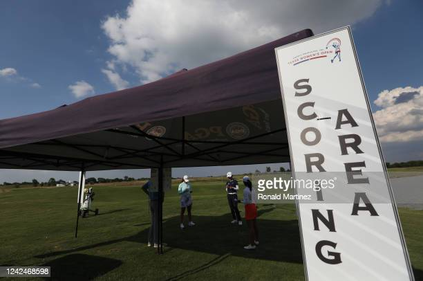 Maria Fassi of Mexico Yu Liu of China and Celine Boutier of France read aloud score cards in the scoring area after playing in the first round of the...
