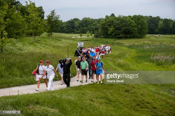 Maria Fassi of the University of Arkansas and Arkansas head coach Shauna Taylor lead the gallery to the 19th green during the Division I Women's Golf...