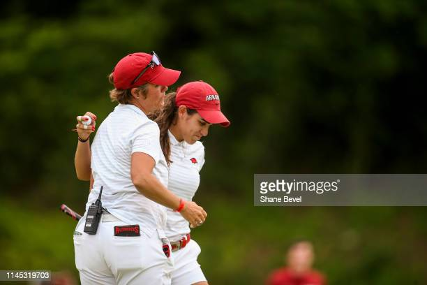 Maria Fassi of the University of Arkansas hugs head coach Shauna Taylor after winning the Division I Women's Golf Stroke Play Championship held at...