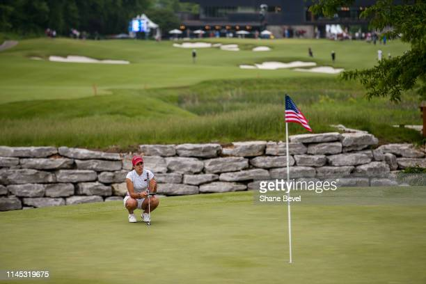 Maria Fassi of the University of Arkansas lines up a putt on the 17th green during the Division I Women's Golf Stroke Play Championship held at...