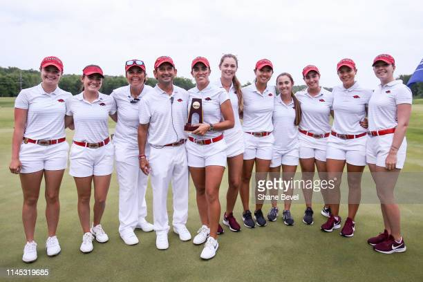 Maria Fassi of the University of Arkansas poses with her team after winning the Division I Women's Golf Stroke Play Championship held at Blessings...