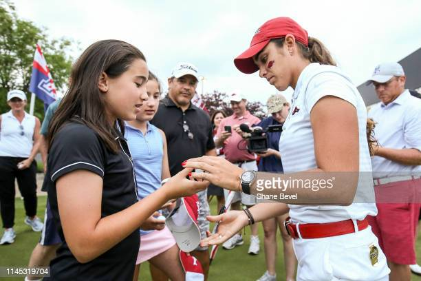 Maria Fassi of the University of Arkansas signs autographs for fans during the Division I Women's Golf Stroke Play Championship held at Blessings...