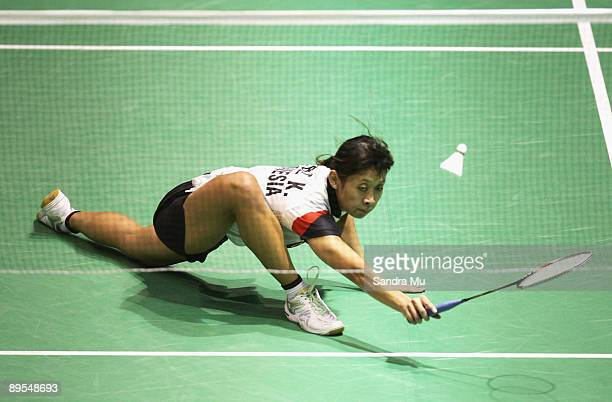 Maria Febe Kusumastuti of Indonesia competes against Sayaka Sato of Japan in the women's single final during the 2009 New Zealand Badminton Open at...