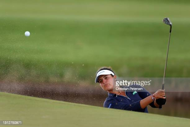 Maria Fernanda Torres of Puerto Rico chips from the bunker onto the 12th green during the second round of the LPGA LOTTE Championship at Kapolei Golf...
