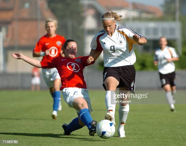Maria Filisova of Russia tackles Isabel Kerschowski of Germany during the Women's U19 European Championship Semi Final between Germany and Russia at...