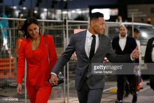 Maria Folau holds hands with husband Israel Folau as he acknowledges a supporter as he leaves Federal Court on December 02 2019 in Melbourne...