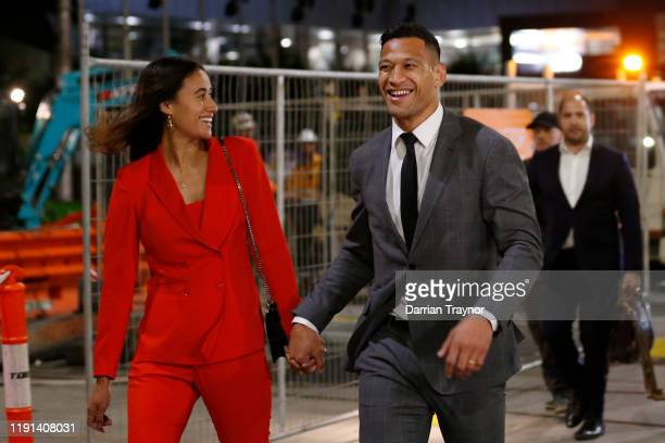 Maria Folau holds hands with husband Israel Folau as he leaves Federal Court on December 02, 2019 in Melbourne, Australia. Folau is meeting with...