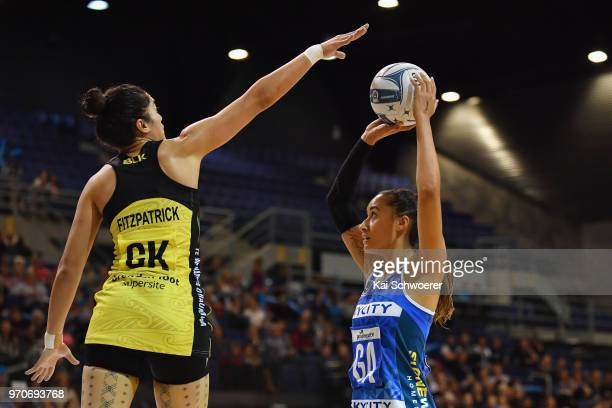 Maria Folau of the Mystics is challenged by Sulu Fitzpatrick of the Pulse during the round six ANZ Premiership match between the Central Pulse and...
