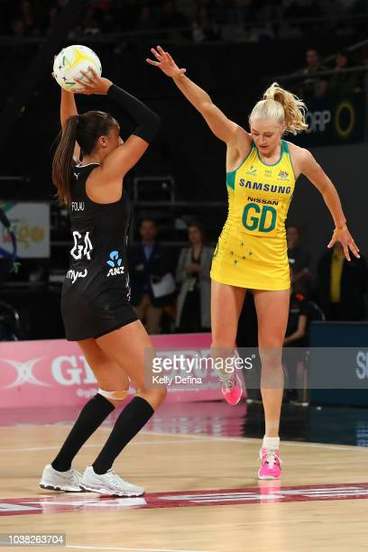 Maria Folau of the Silver Ferns shoots while under the defensive pressure of Jo Weston of the Diamonds during the Quad Series International Test...