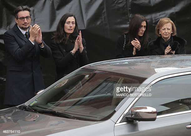 Maria Franca Ferrero the widow and his son Giovanni Ferrero applaud the coffin of Michele Ferrero on February 18 2015 in Alba northern Italy...