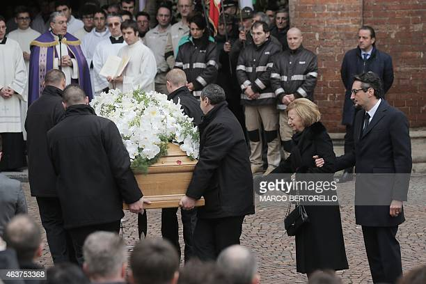 Maria Franca Ferrero the widow and his son Giovanni Ferrero react as the coffin of Michele Ferrero is carried into the church for the funeral on...