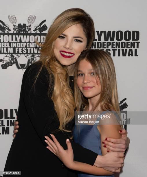Maria Gabriela Cardenas and Harlow Rocca arrive at A Dark Foe Film Premiere on February 15 2020 in Los Angeles California