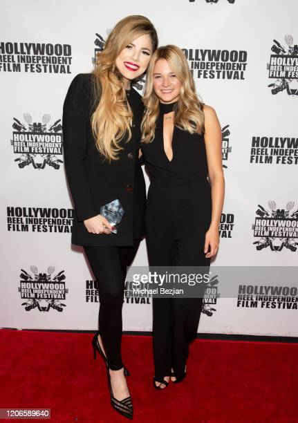 Maria Gabriela Cardenas and Kaitlyn Squires arrive at A Dark Foe Film Premiere on February 15 2020 in Los Angeles California