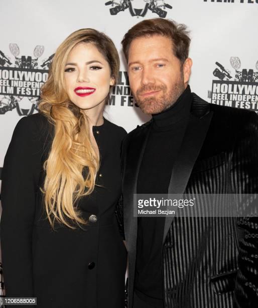 Maria Gabriela Cardenas and Oscar Cardenas arrive at A Dark Foe Film Premiere on February 15 2020 in Los Angeles California