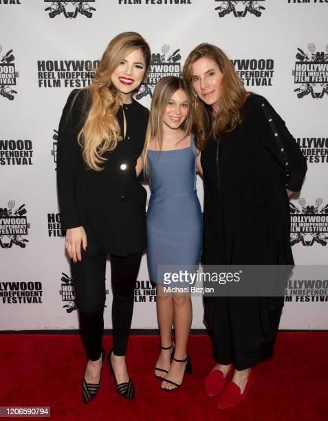 Maria Gabriela Cardenas Harlow Rocca and Amy Williams arrive at A Dark Foe Film Premiere on February 15 2020 in Los Angeles California