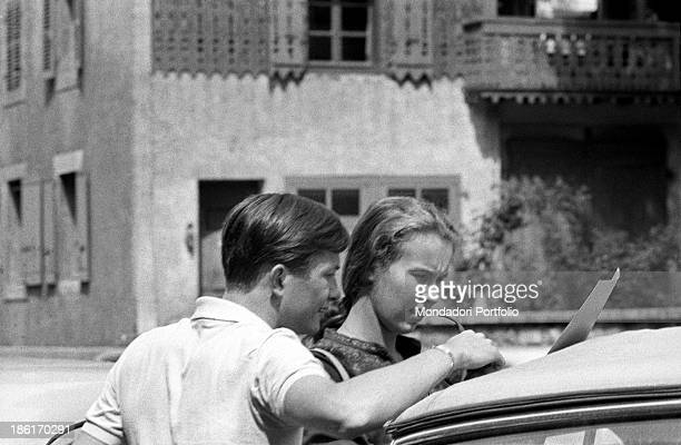 Maria Gabriella of Savoy daughter of the last king of Italy Umberto II consults a sheet together with Robert Matossian a friend of hers and a...