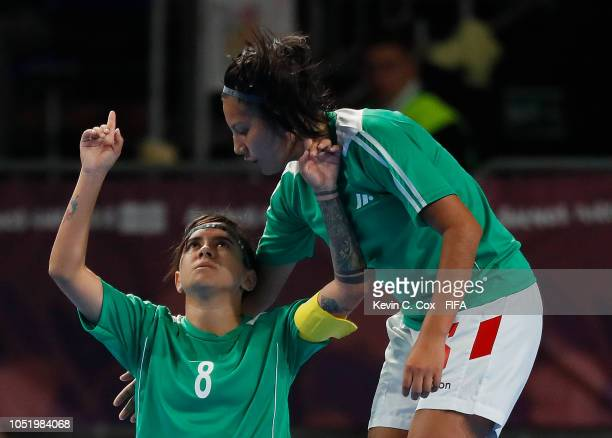 Maria Galvez of Bolivia celebrates scoring the first goal against of Trinidad & Tobago with Michelle Pacheco in the Women's Futsal Group C match...