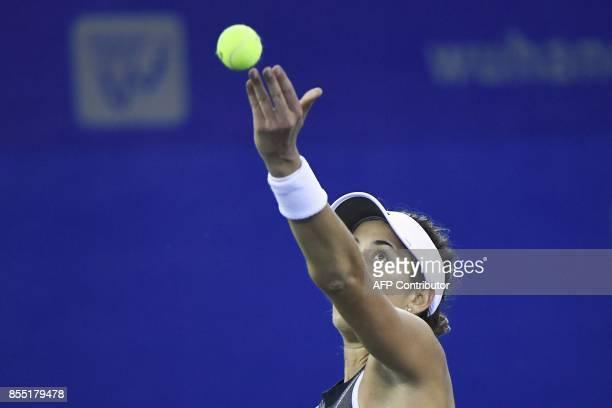 Maria Garbine Muguruza of Spain serves the ball against Jelena Ostapenko of Latvia during their women's singles quarterfinal match at the WTA Wuhan...