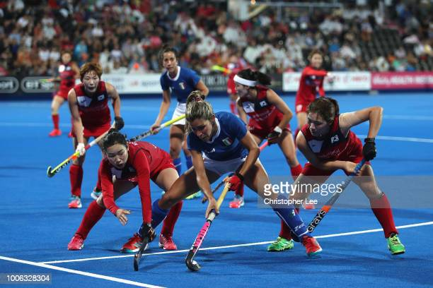 Maria Garraffo of Italy holds off Su Ji Choi of Korea and Hyejeong Shin of Korea during the Pool A game between South Korea and Italy of the FIH...