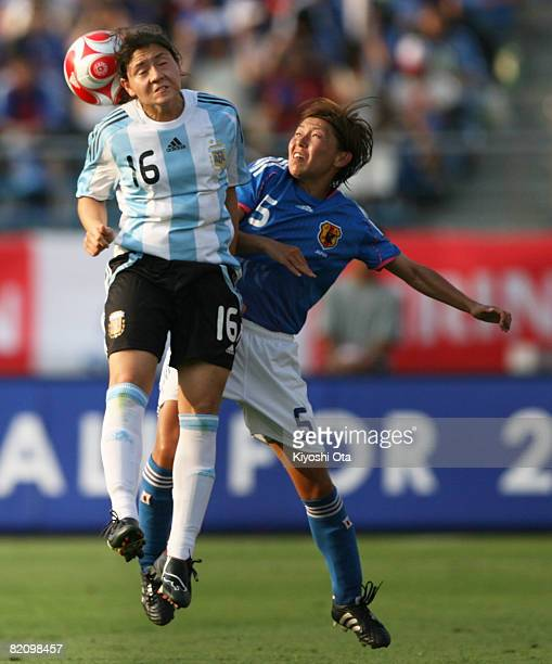 Maria Gimena Blanco of Argentina and Miyuki Yanagita of Japan fight the ball during the women's international friendly soccer match between Japan and...
